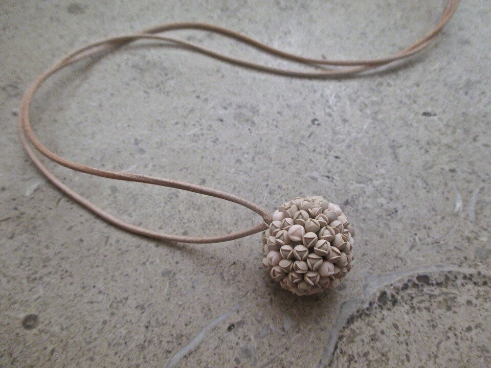 Bloom pendant on leather cord