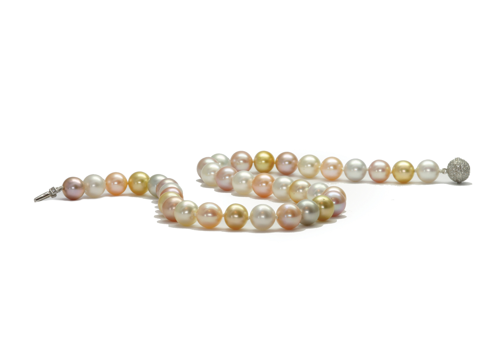 Freshwater & South Sea pearls on a 18 carat gold & diamond clasp