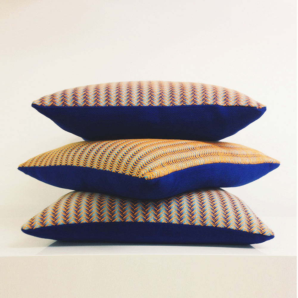 Stack of three: Opulent Wave and Reflective Twill cushions